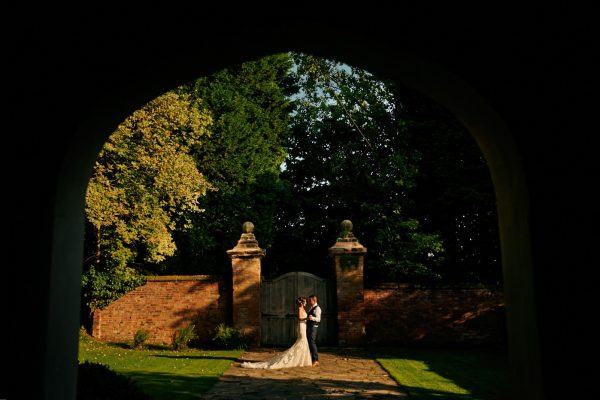 Bride and groom in gardens at Gorcott Hall