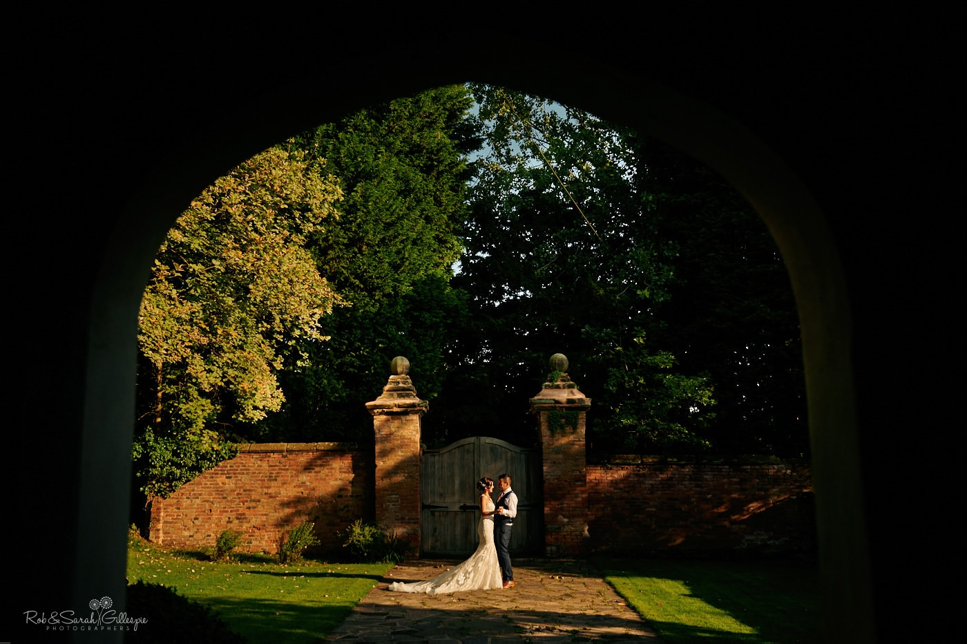 Bride and groom in bright sunlight during Gorcott Hall wedding