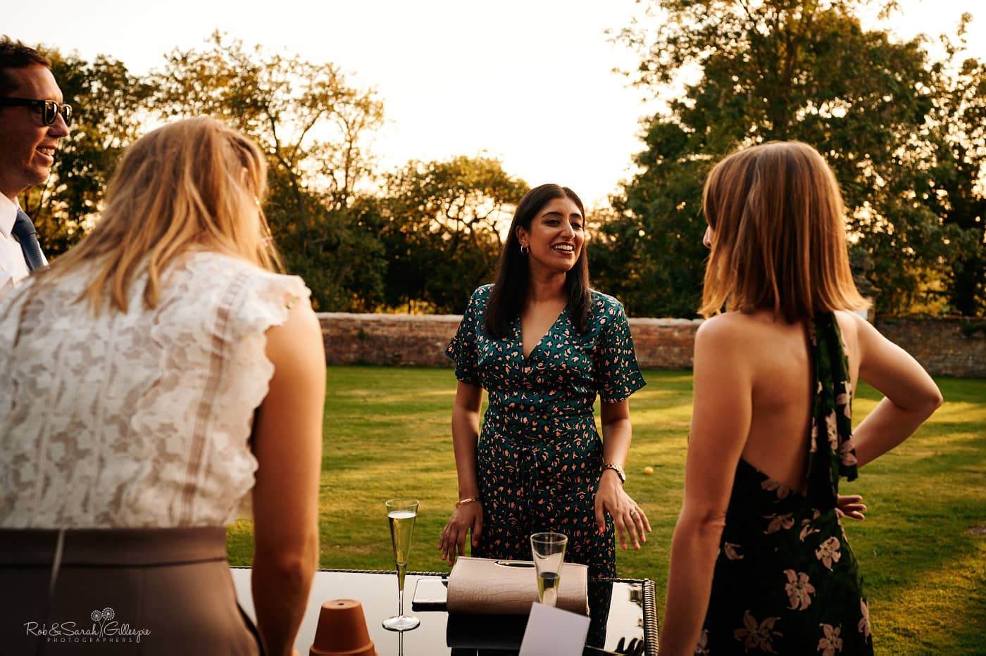 Wedding guests chat during evening reception party