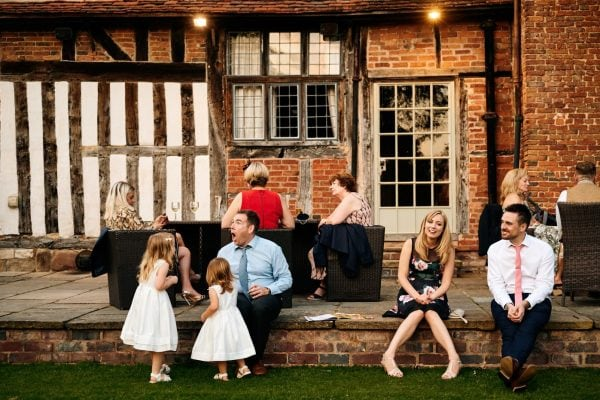 Wedding guests chat and relax at Gorcott Hall wedding