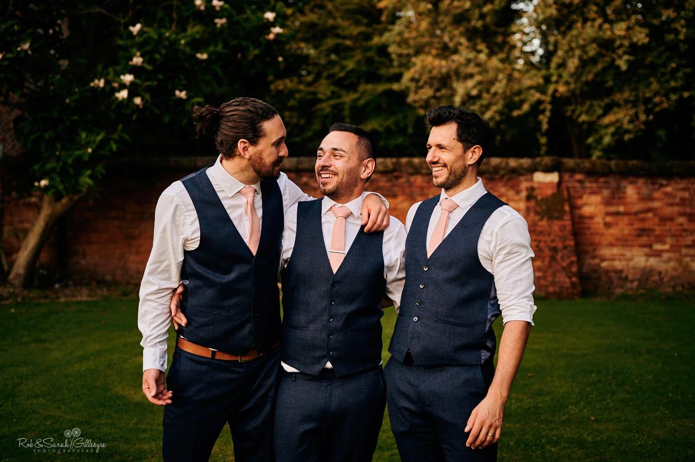Groom and groosmen having a laugh