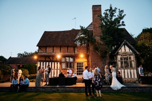 Gorcott Hall in evening with wedding guests relaxing