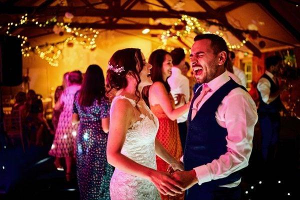 Bride and groom dancing with weddin guests