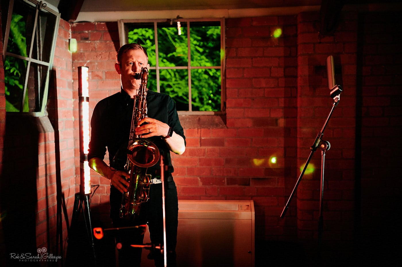 Saxophonist plays during wedding party