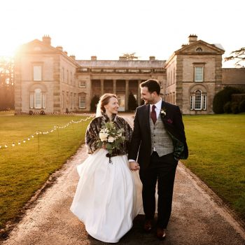 Bride and groom at Compton Verney on sunny winter's day