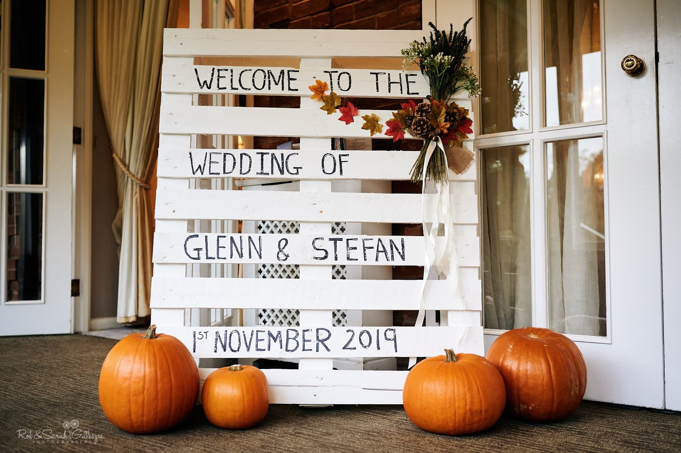Welcome sign for wedding at Moor Hall Hotel with decorative pumpkins and flowers