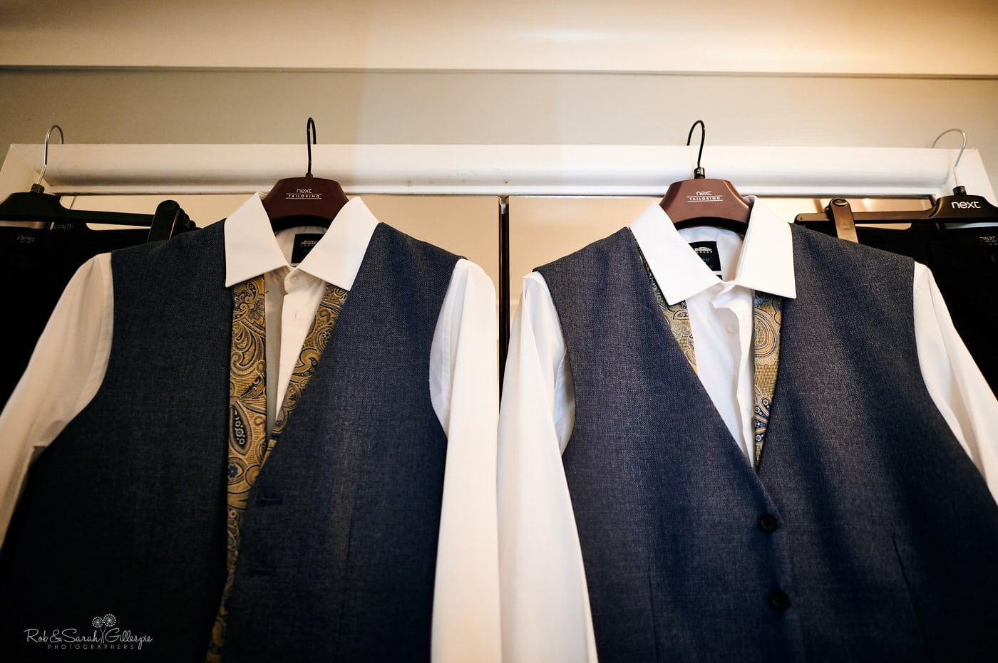 Two suits and shirts for grooms at Moor Hall hotel same-sex wedding