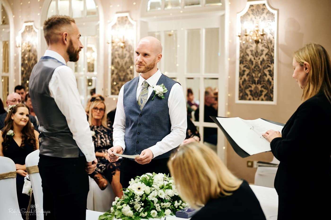 Two grooms exchange wedding vows at Moor Hall Hotel