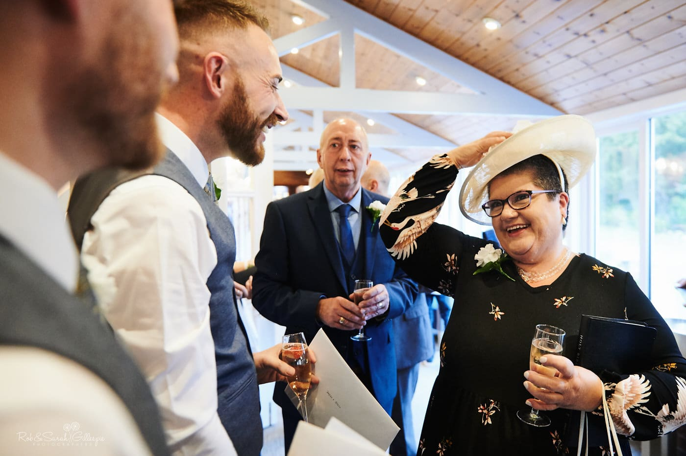 Grooms congratulated by wedding guests