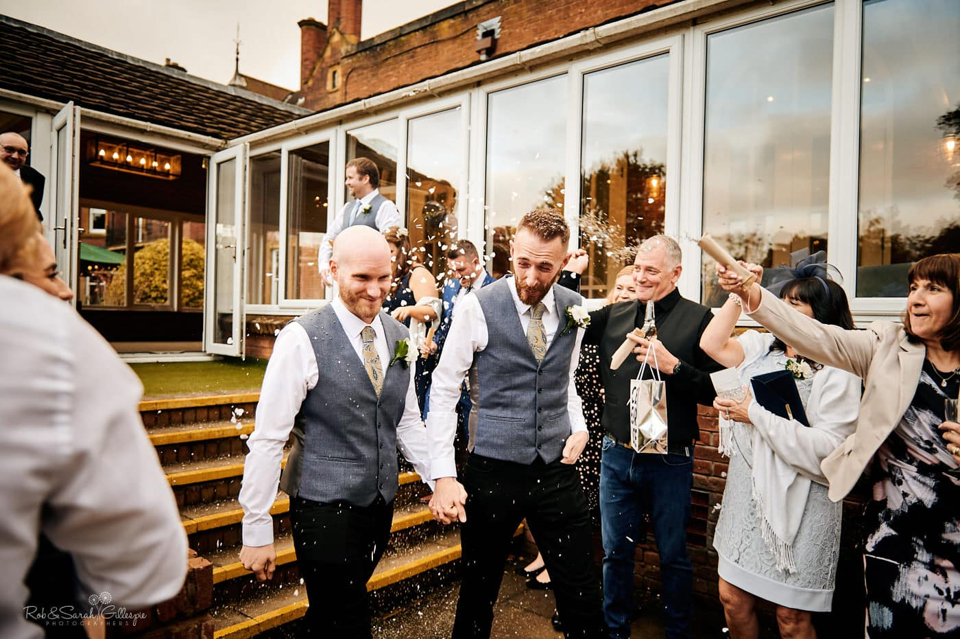 Guests throw confetti at Moor Hall Hotel same-sex wedding