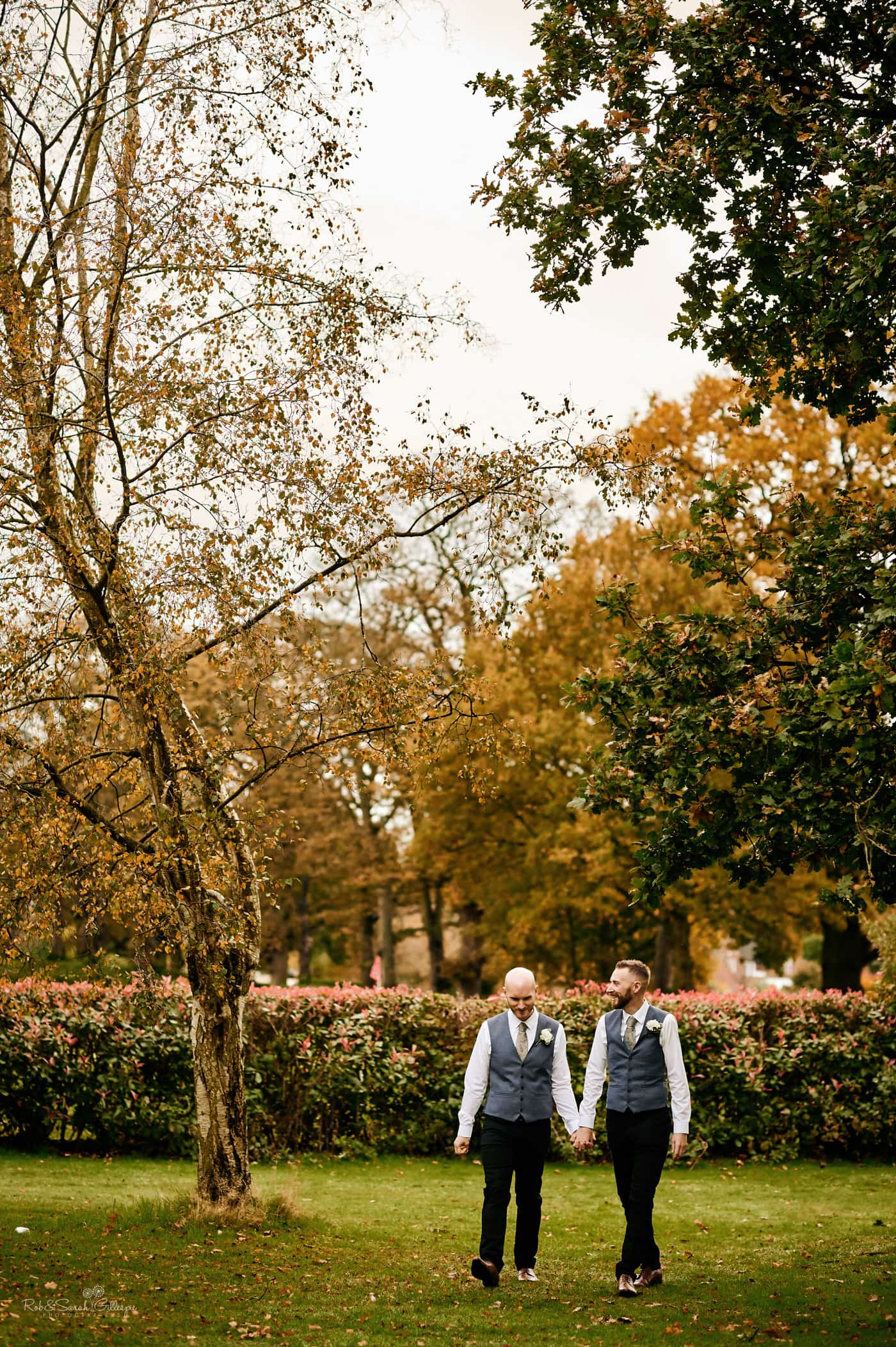 Two grooms walking in gardens at Moor Hall Hotel