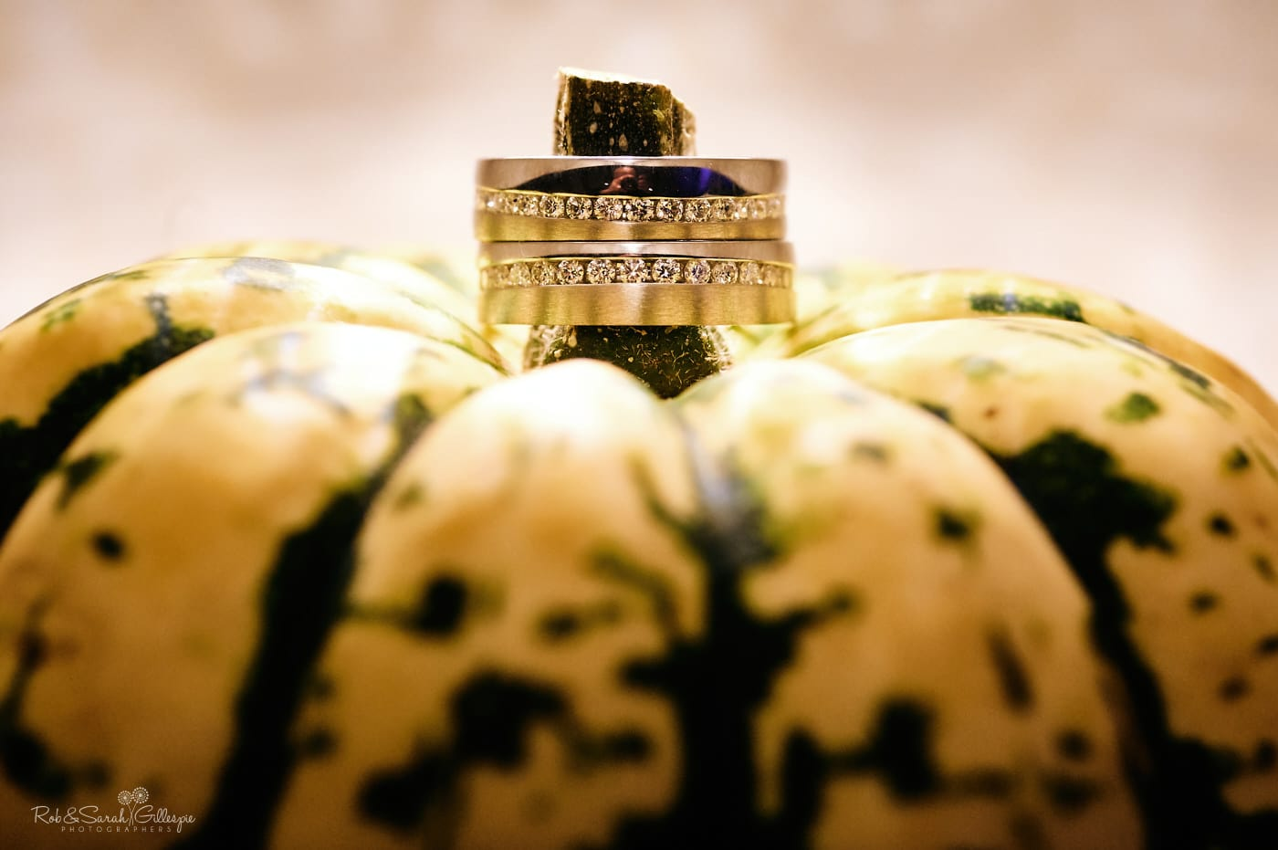 Wedding rings on top of yellow and green pumpkin