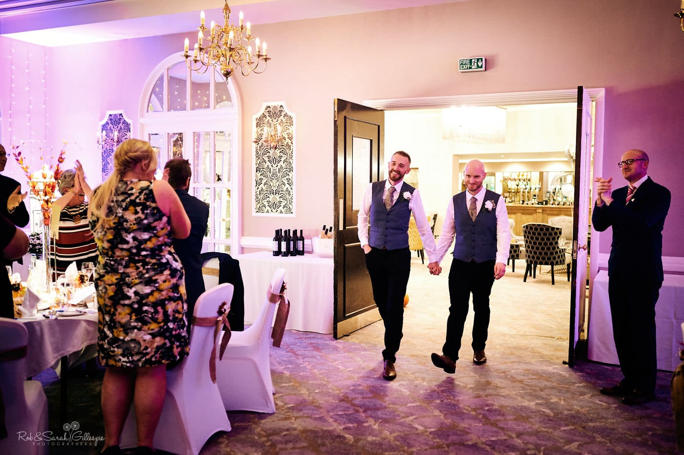 Two grooms enter wedding breakfast at Moor Hall Hotel