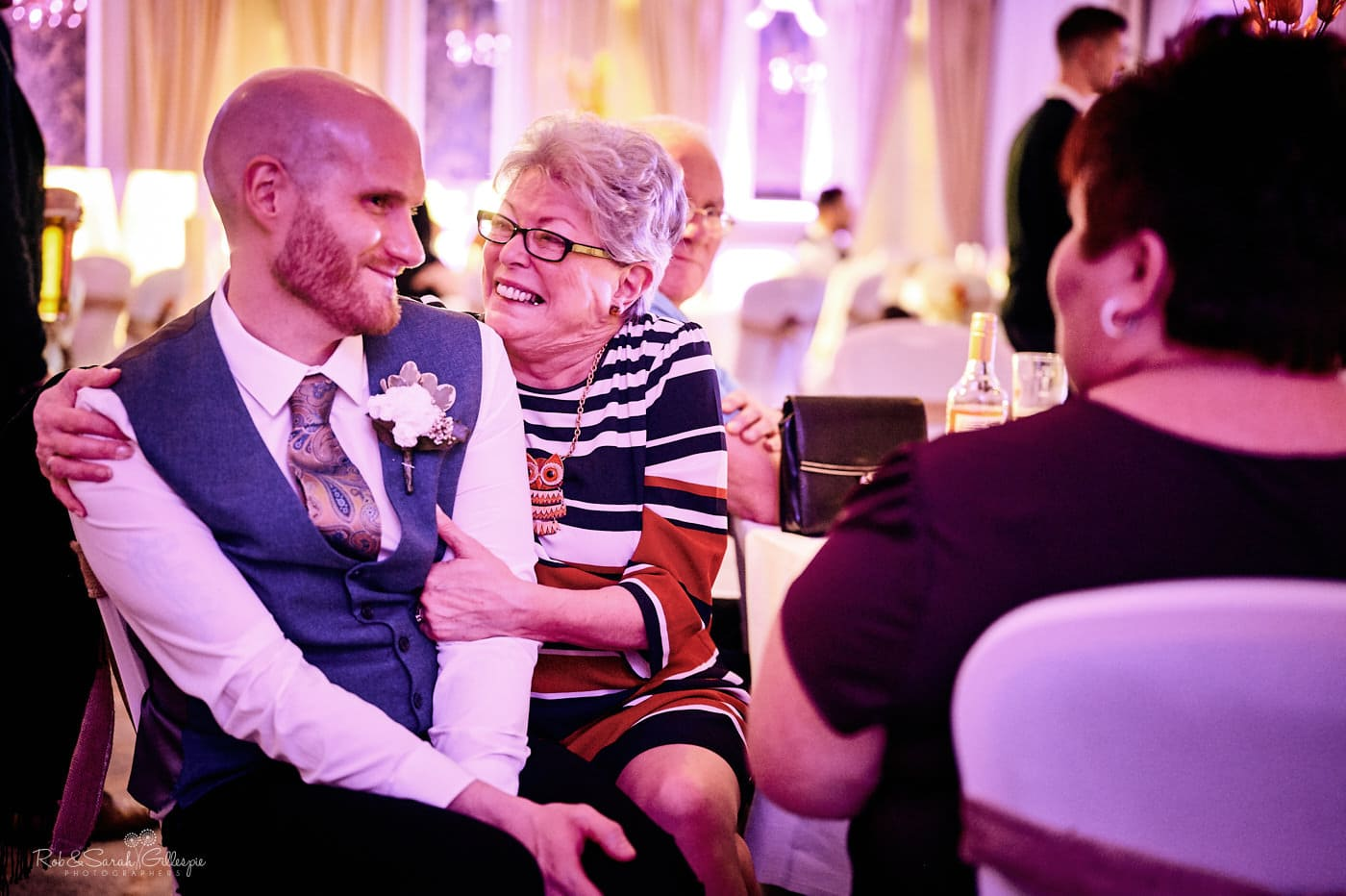 Wedding guests relax and chat at reception party
