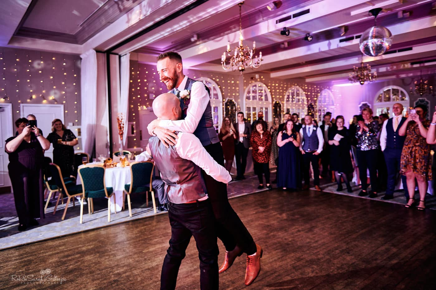 Two grooms first dance at Moor Hall Hotel wedding