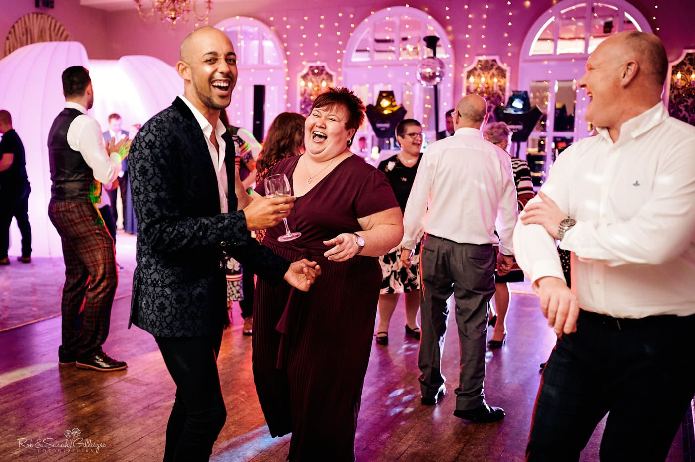 Wedding guests dance at reception party