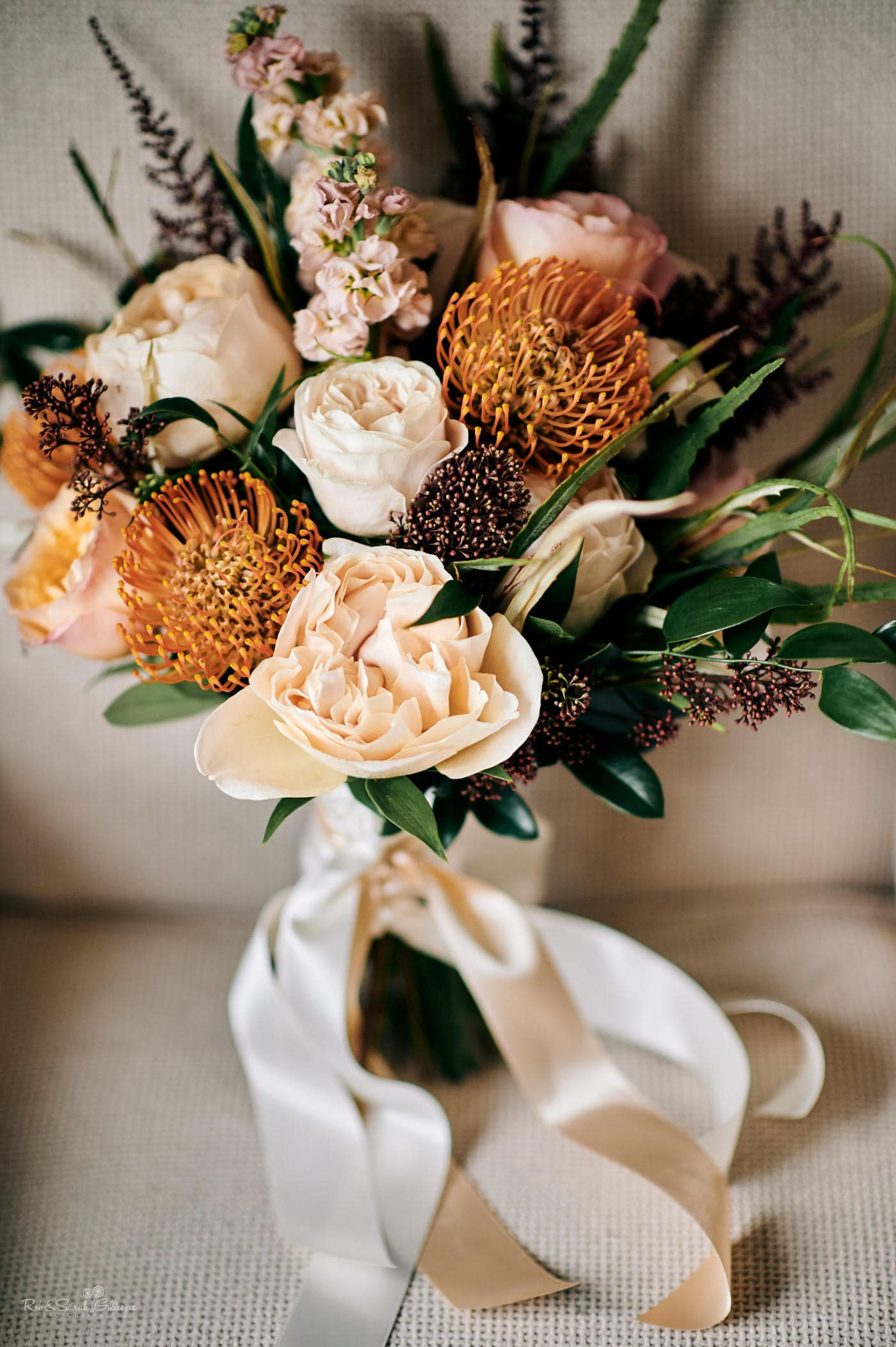 Beautiful bridal bouquet with orange and cream flowers