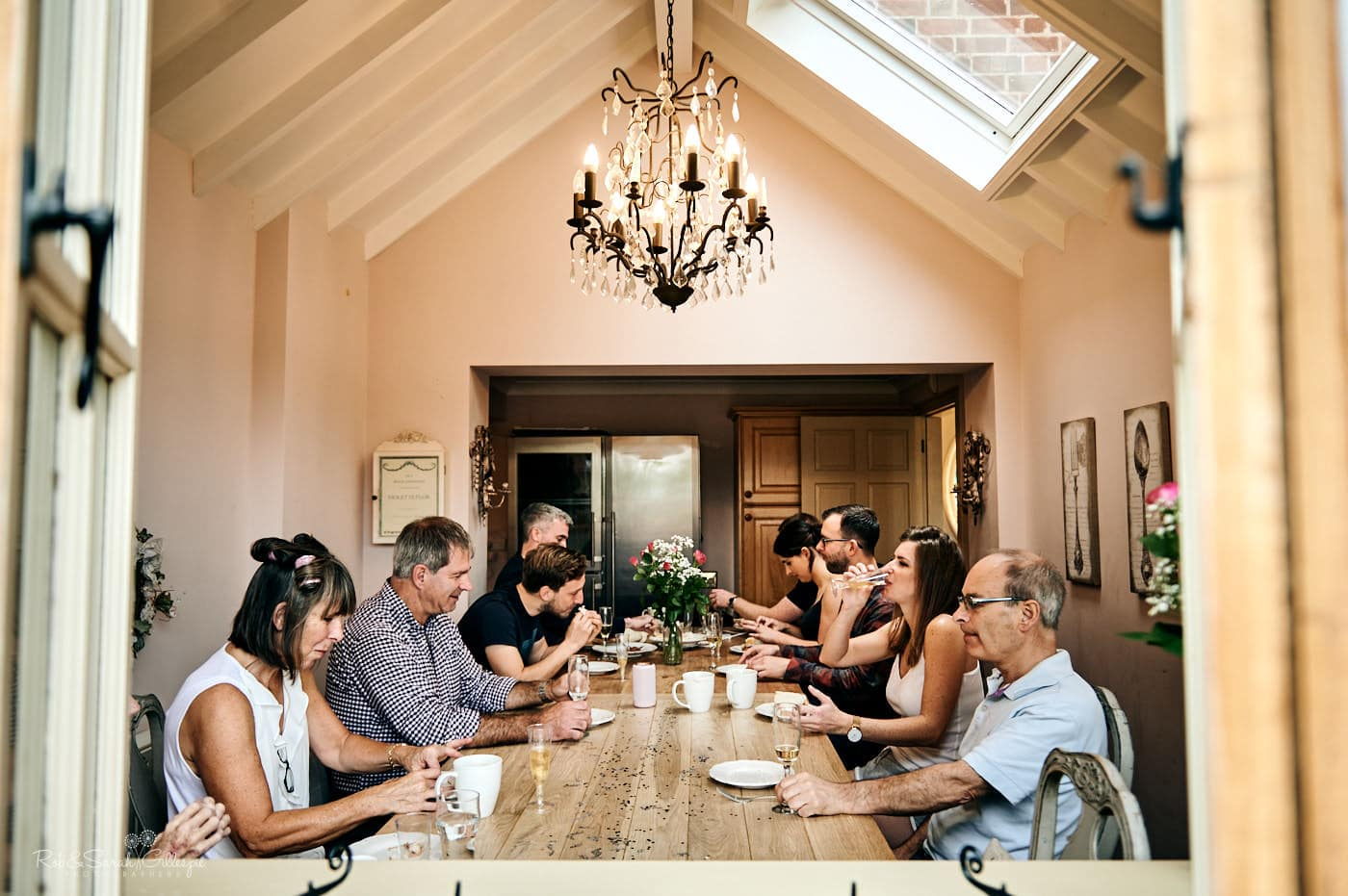 Groom and family have breakfast together before wedding