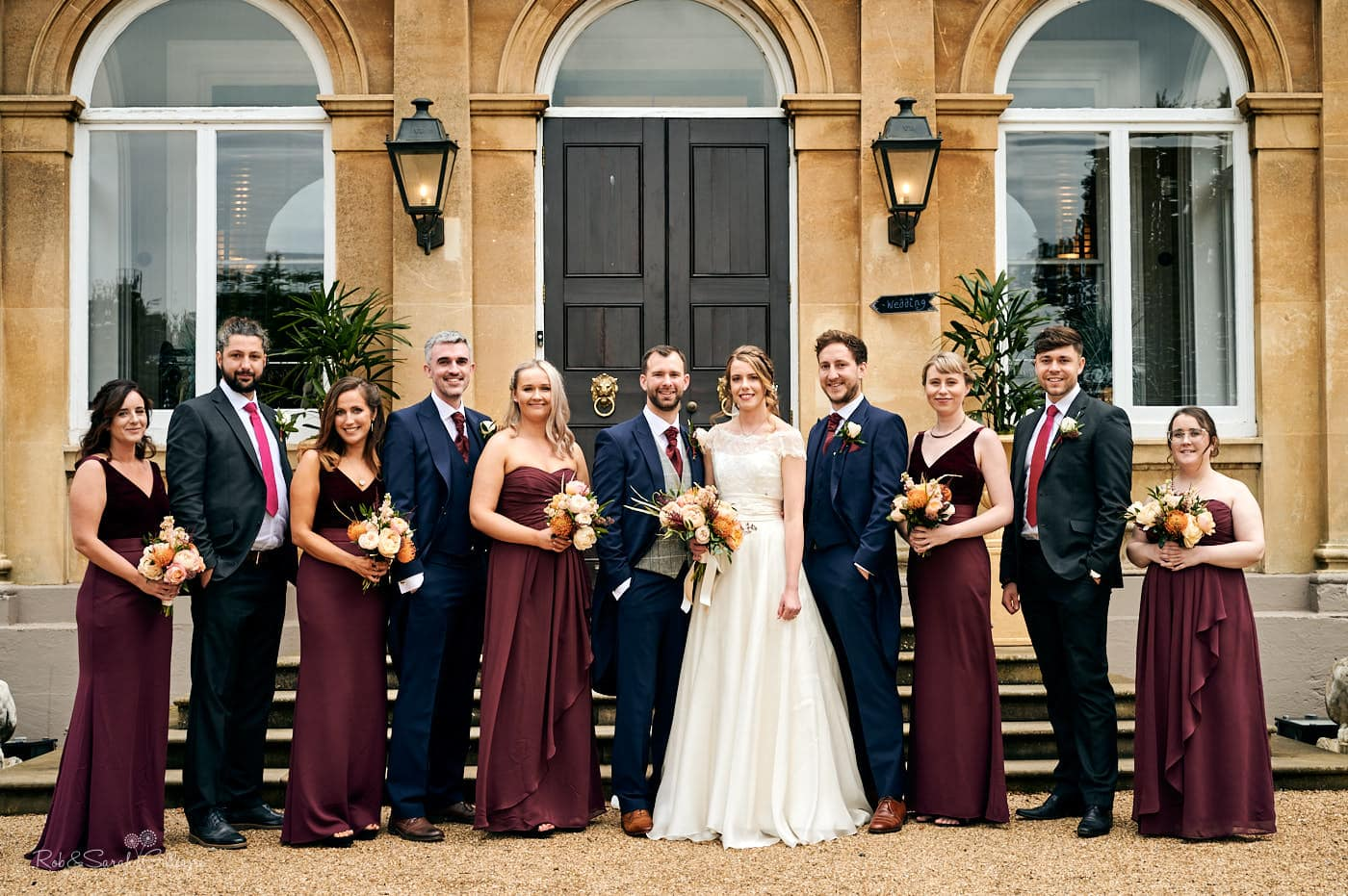 Group photo of bridal party outside Spring Grove House in Worcestershire