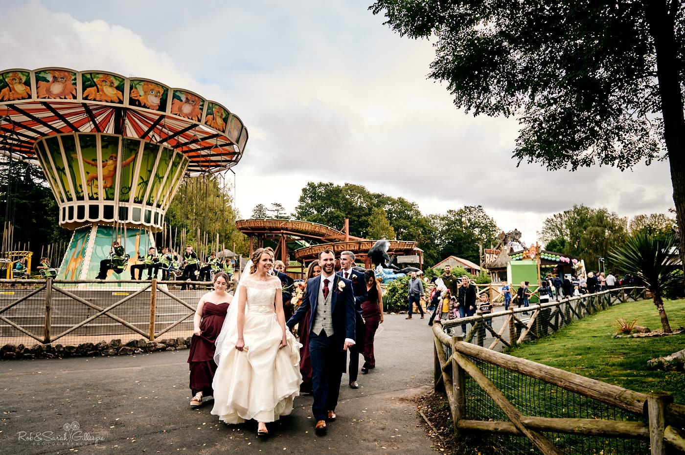 Bridal party walk through fairground
