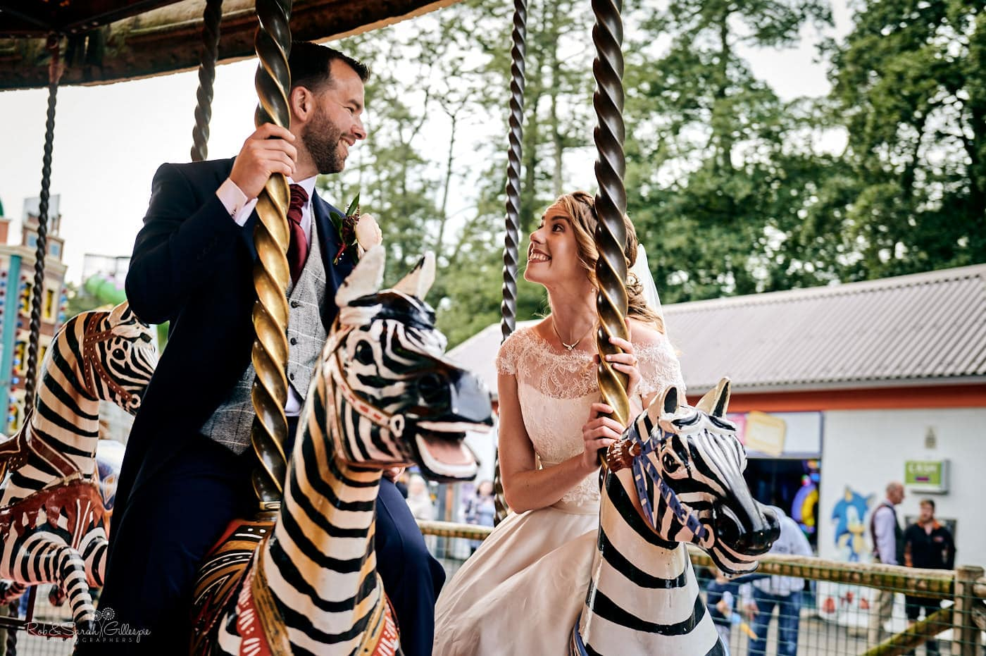 Bride and groom on carousel at Spring Grove House wedding