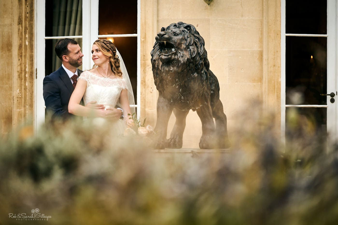 Bride and groom in grounds at Spring Grove House