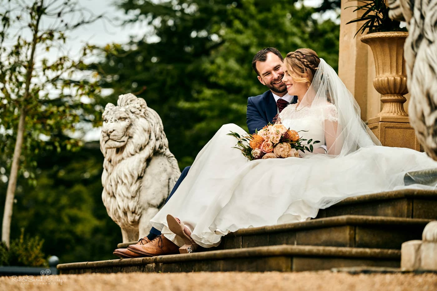 Bride and groom sitting on steps at Spring Grove House wedding