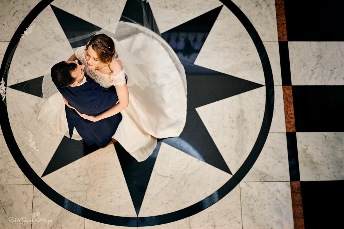 Looking down on bride and groom standing together on beautiful marble floor at Spring Grove House