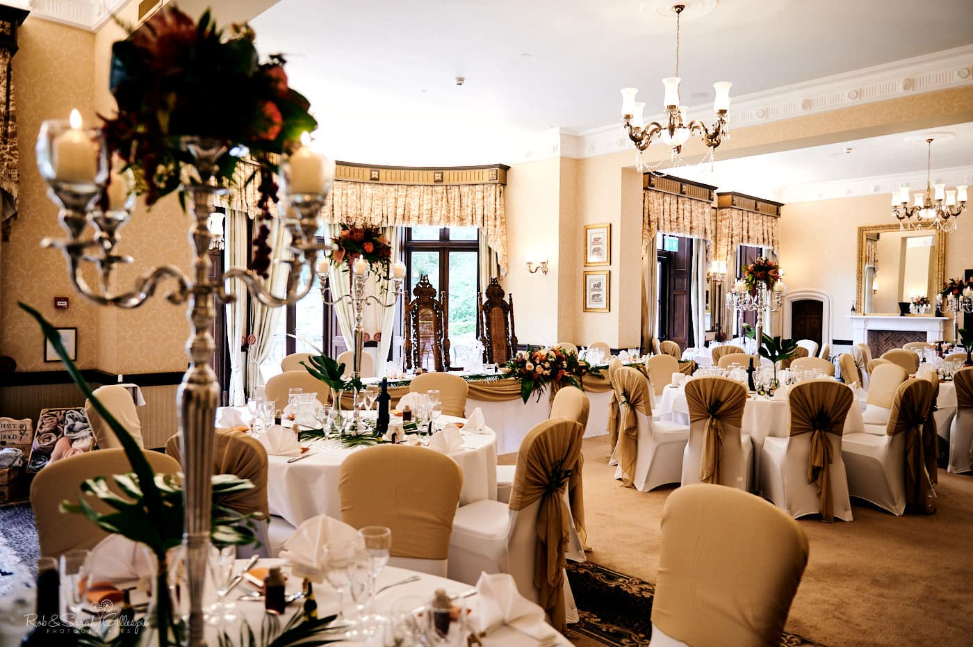 Spring Grove House set up ready for wedding breakfast with round tables and decoration