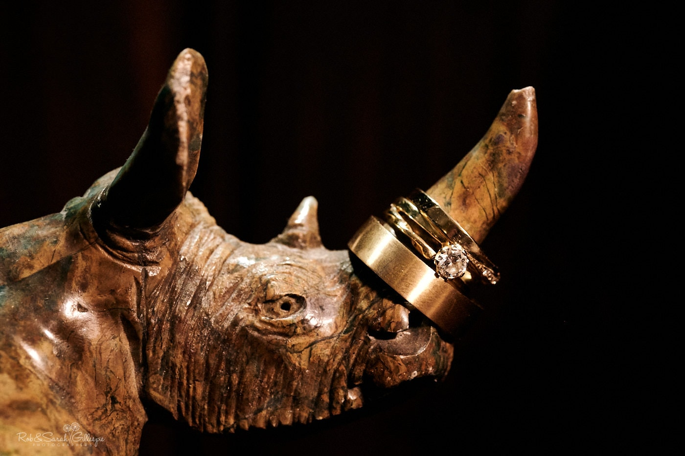 Wedding rings on wooden rhino statue