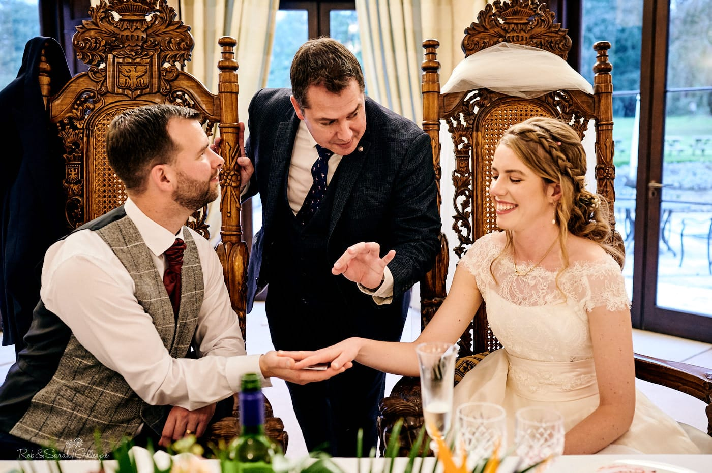 Magician performs card trick for bride and groom