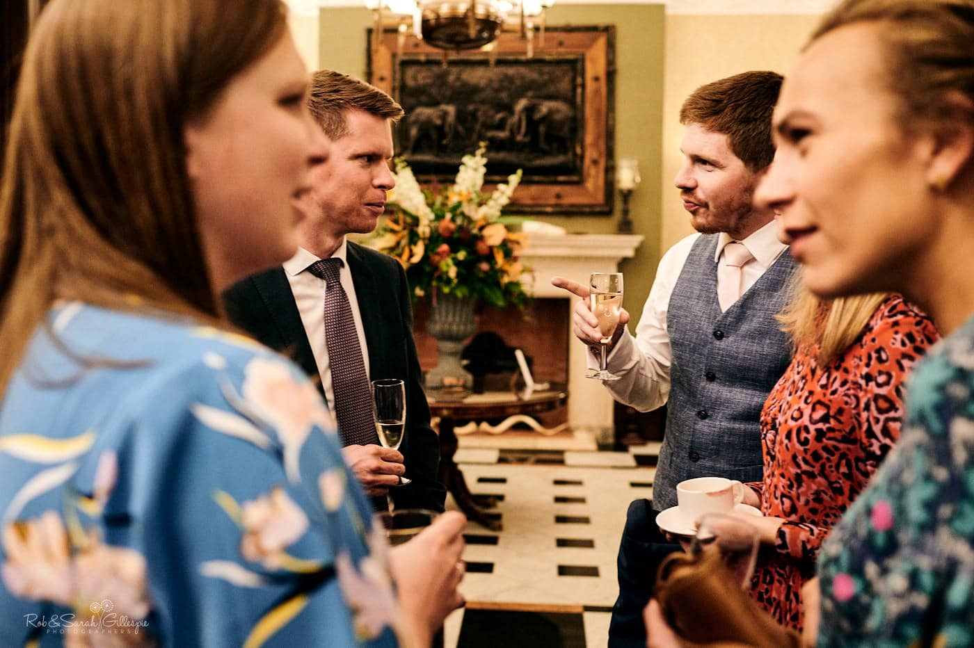 Wedding guests chat after meal at Spring Grove House
