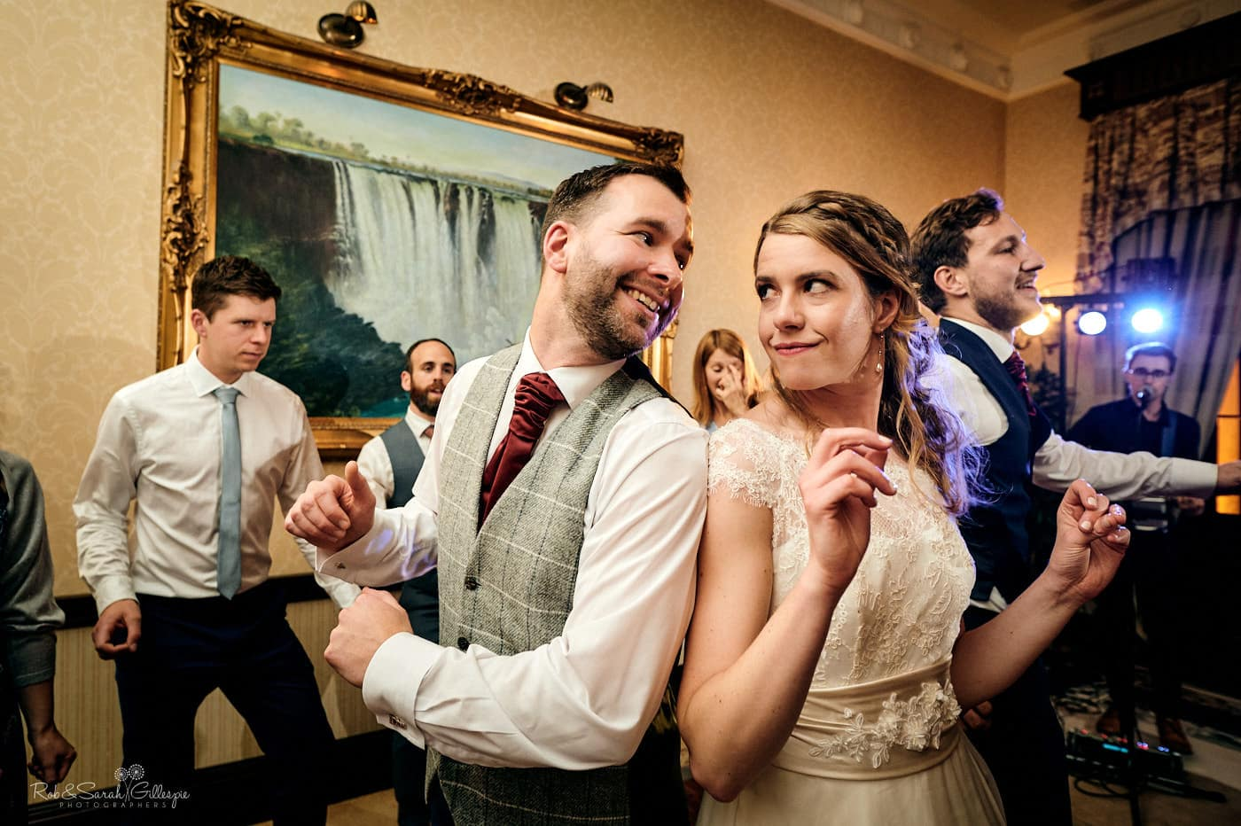 Bride and groom dancing together at Spring Grove House wedding reception