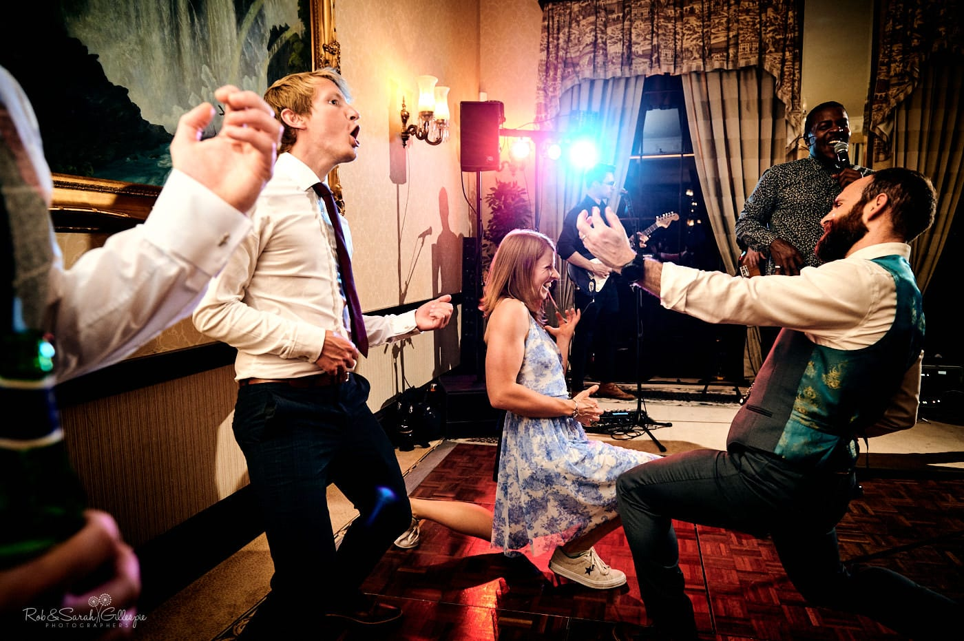 Wedding guests dance to live music at Spring Grove House