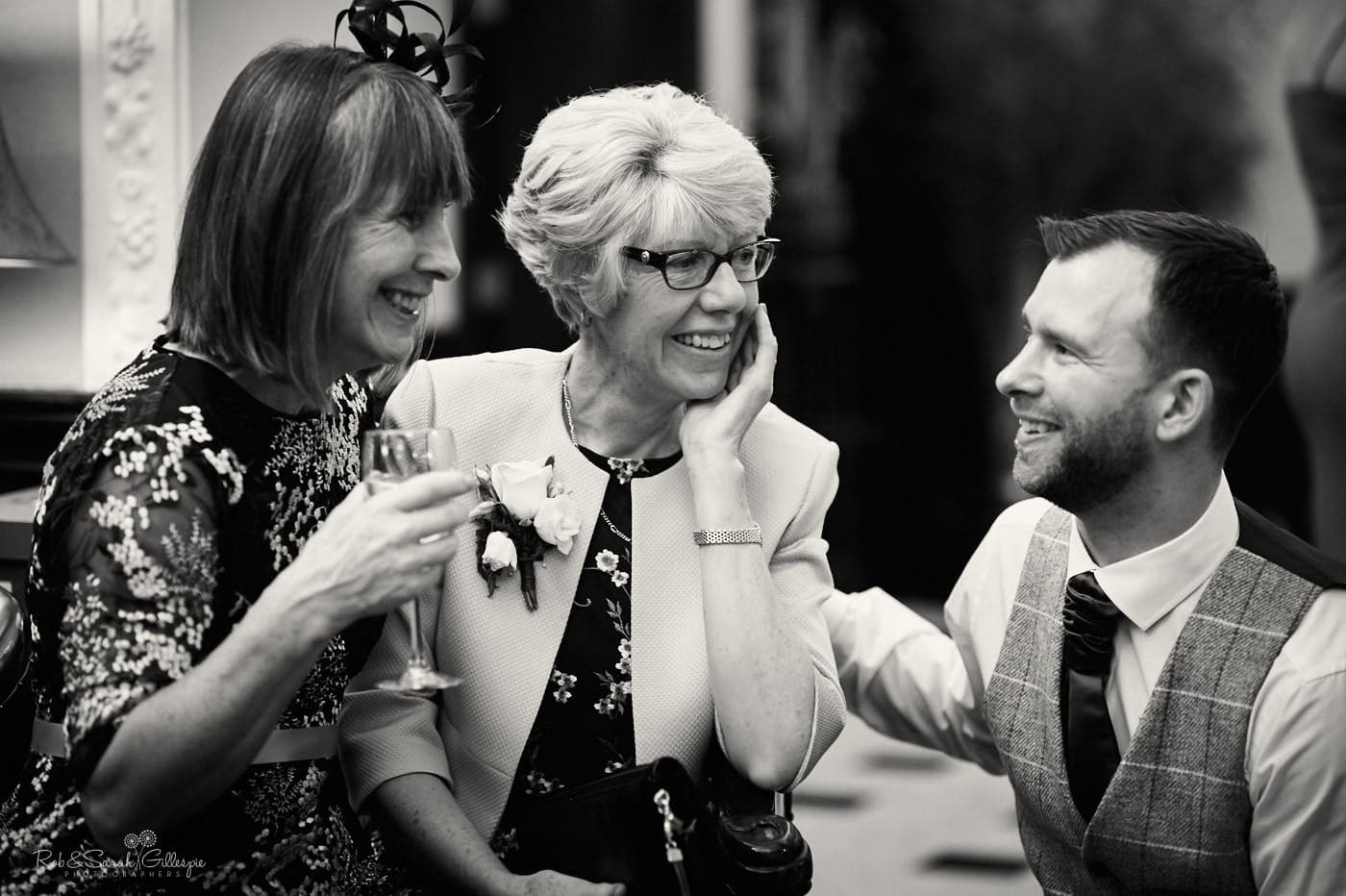Wedding guests chat at reception party