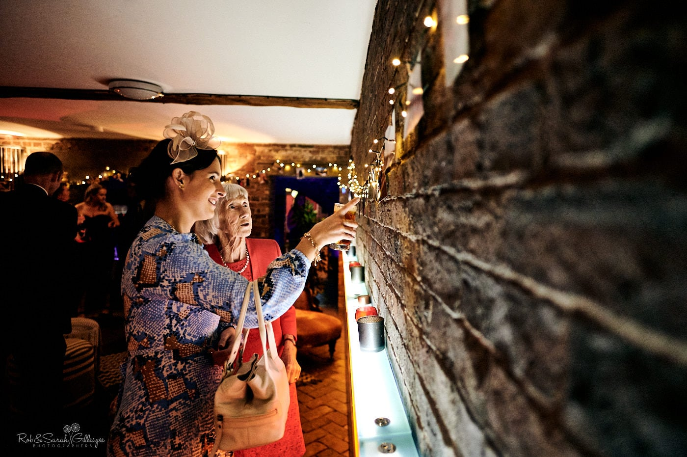 Wedding guests look at old photos at reception party