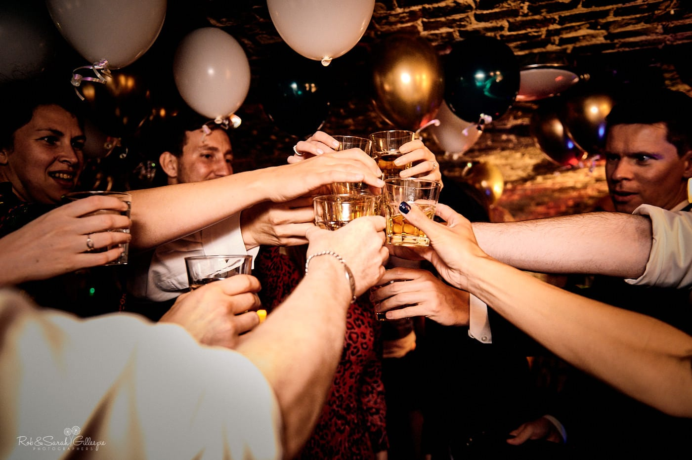 Wedding guests raise toast at Spring Grove house reception party
