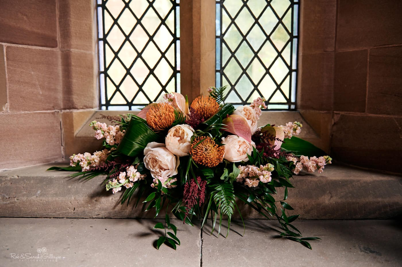 Beautiful wedding flowers on window ledge at church