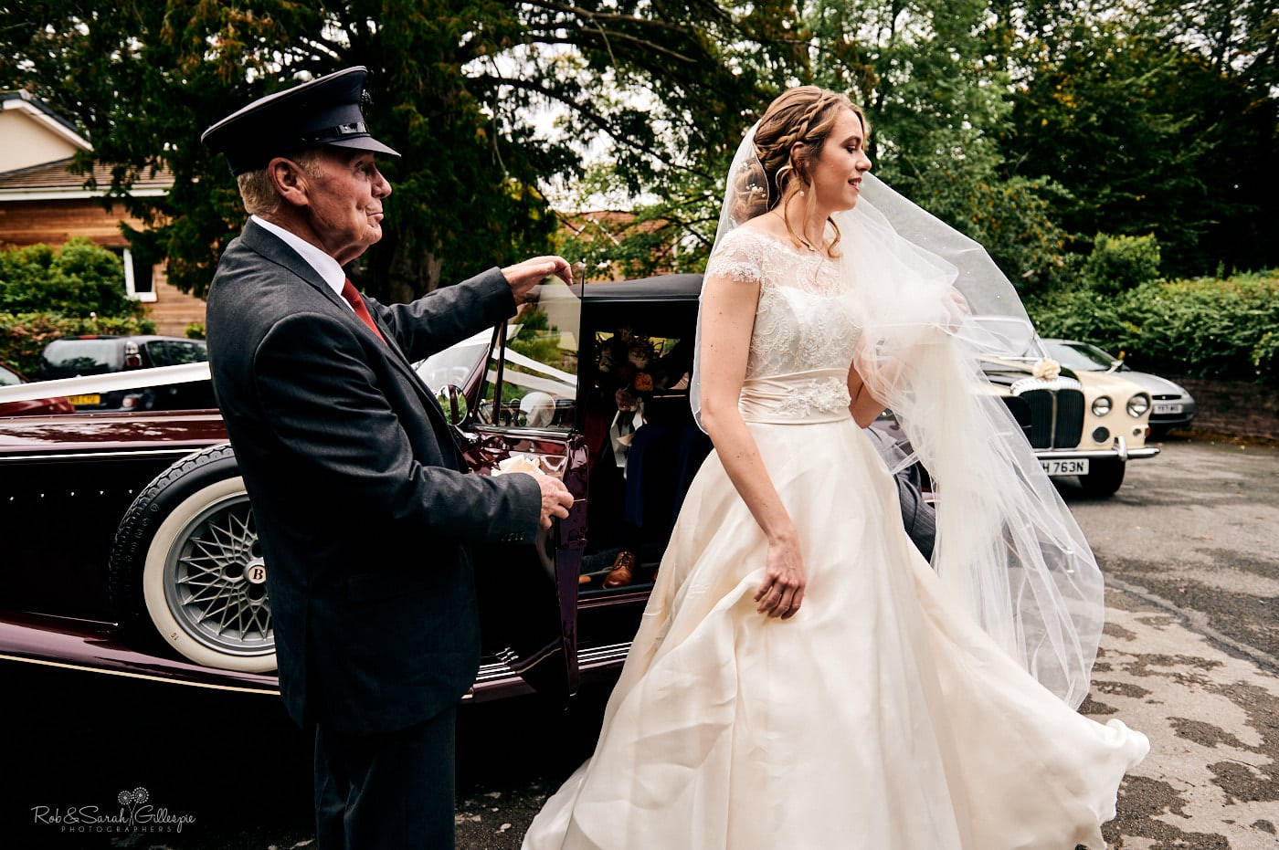 Bride gets out of car for wedding St Peter's church Pedmore