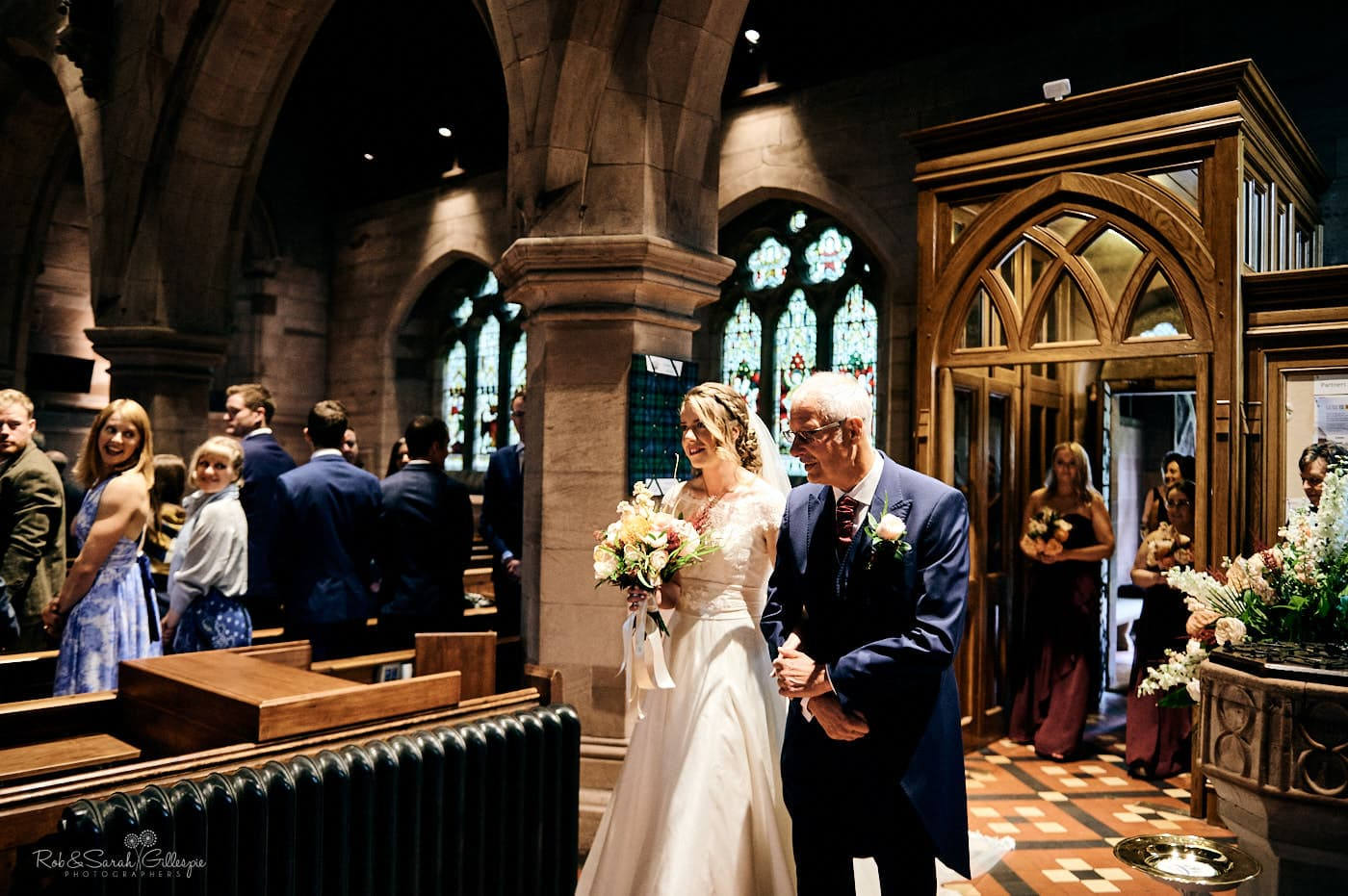Bride and father enter St Peter's church Pedmore for wedding service