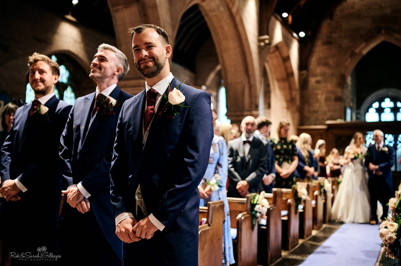 Groom waiting for bride at St Peter's church Pedmore wedding