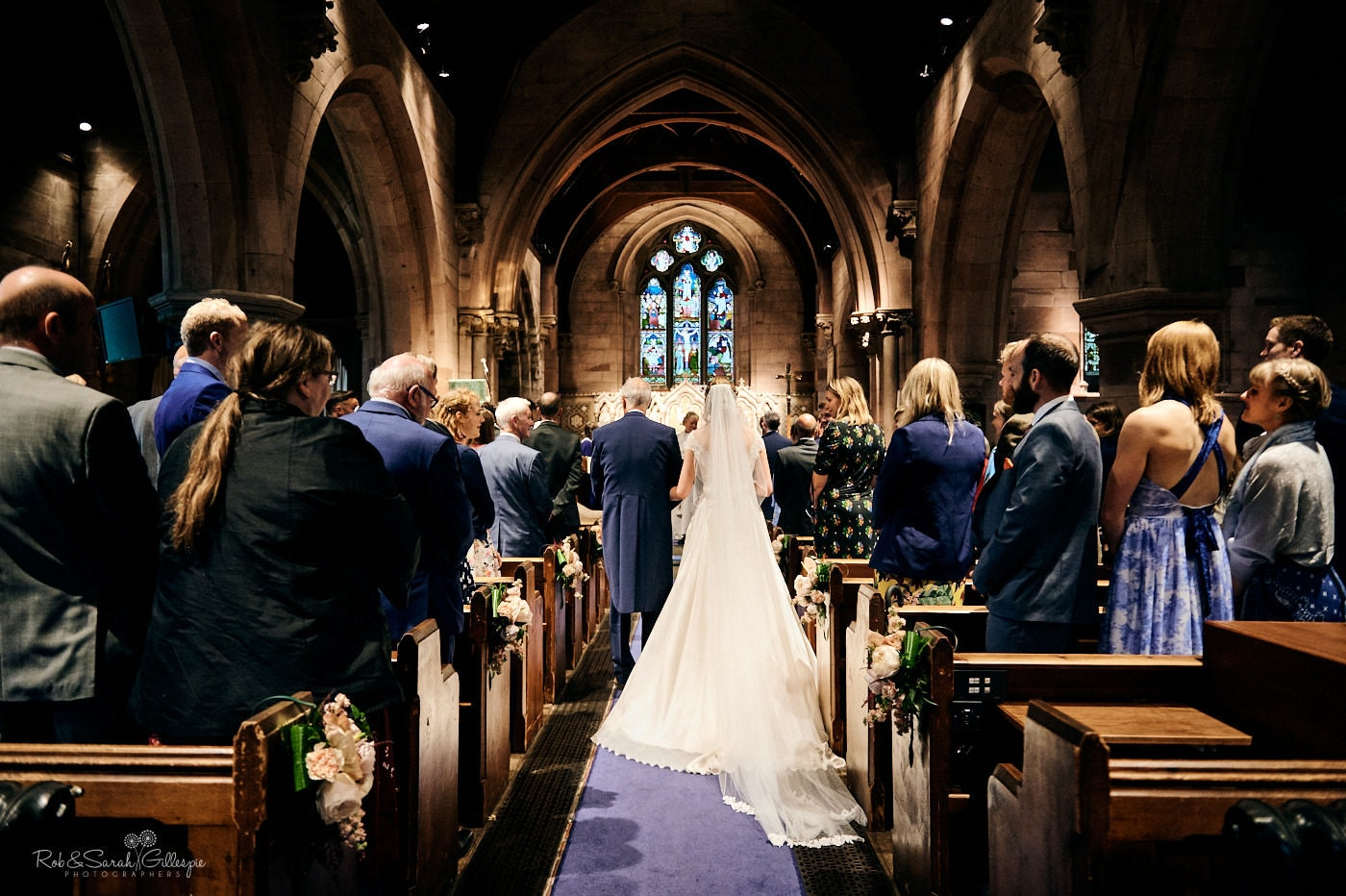 Bride and father walk up aisle at St Peter's church Pedmore