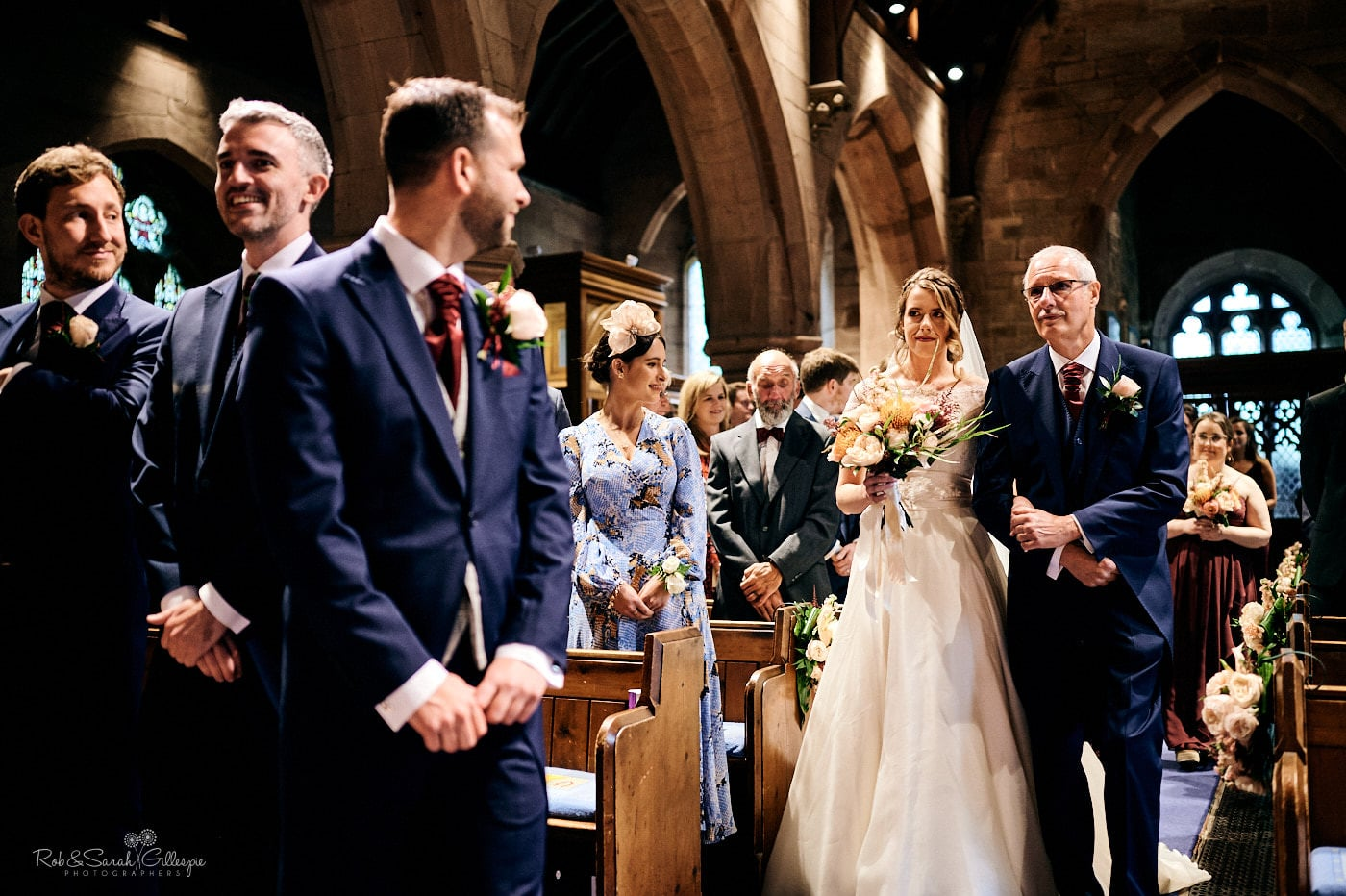Bride and groom see each other for the first time during church wedding ceremony