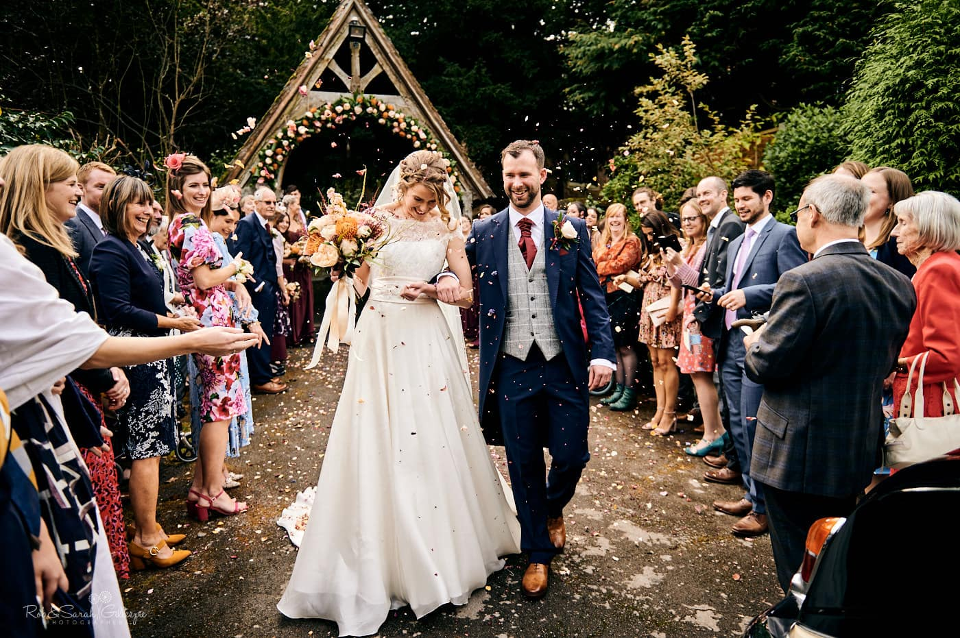 Bride and groom have confetti thrown at St Peter's church Pedmore