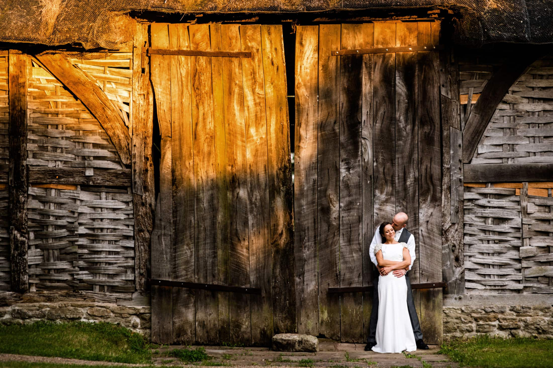 Bride and groom at Avoncroft Museum with sunset light