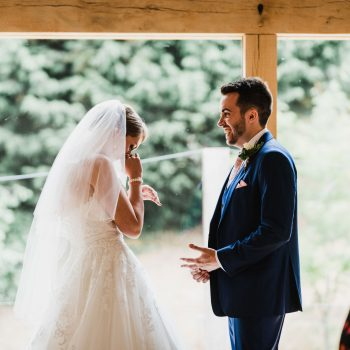 Wedding at Mill Barns with bride and groom emotional during ceremony