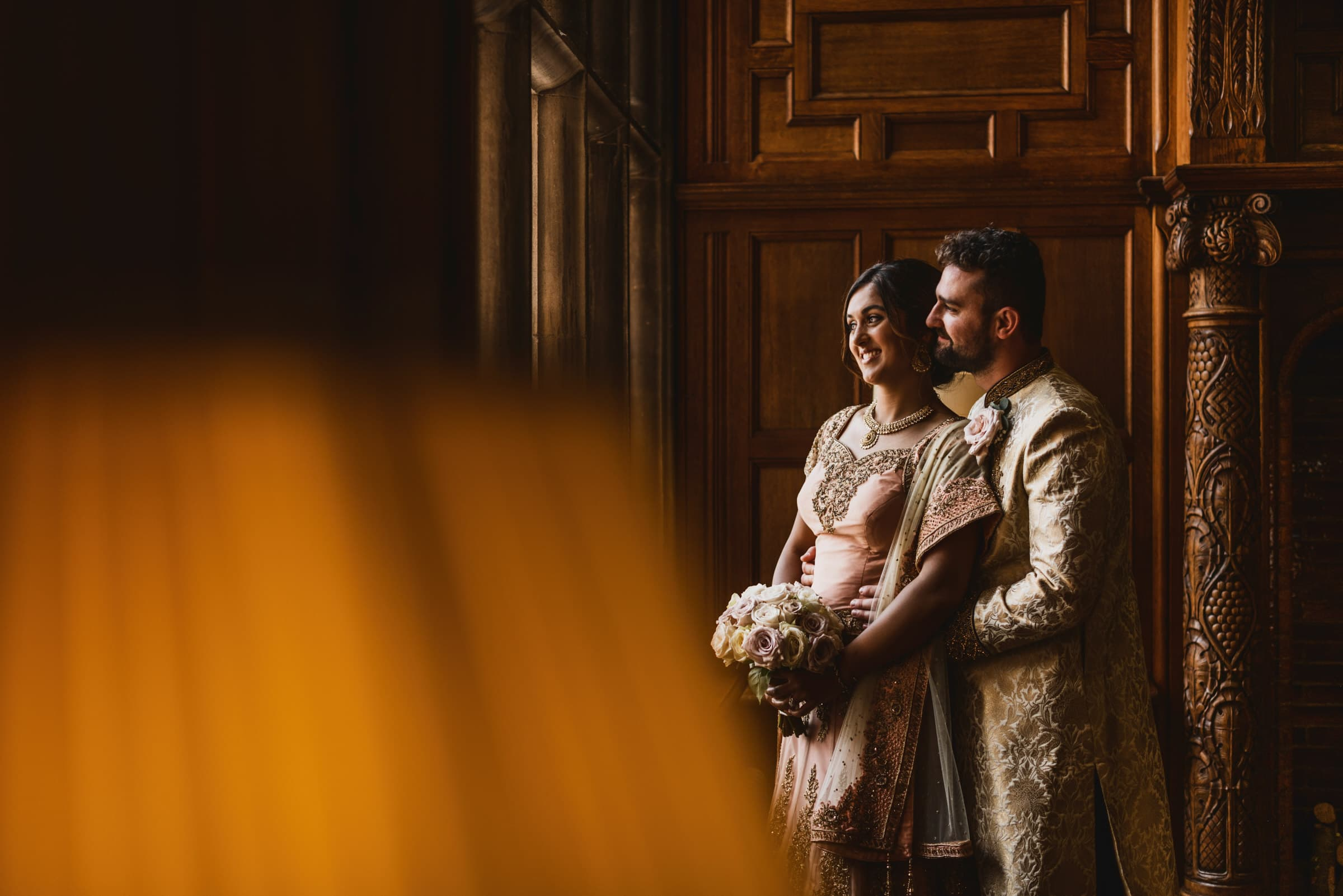 Bride and groom in indian outfits at Pendrell Hall