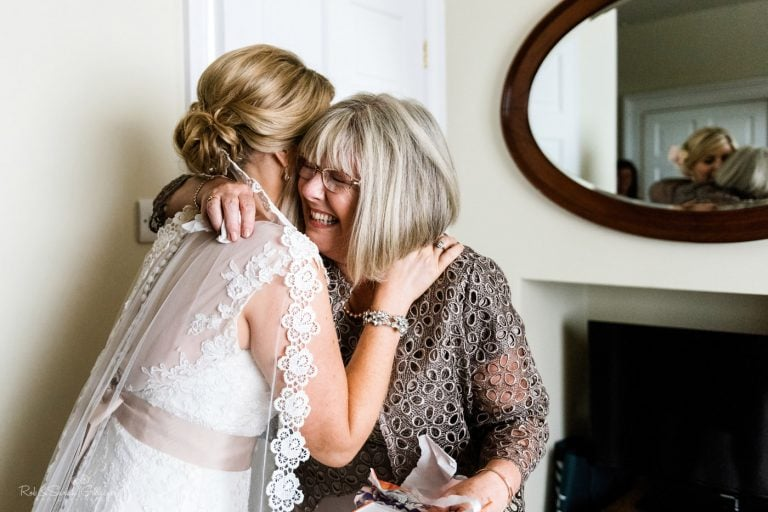Bride hugs mum as she prepares for wedding
