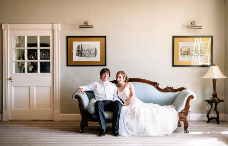 Bride and goom on sofa at Warwick House