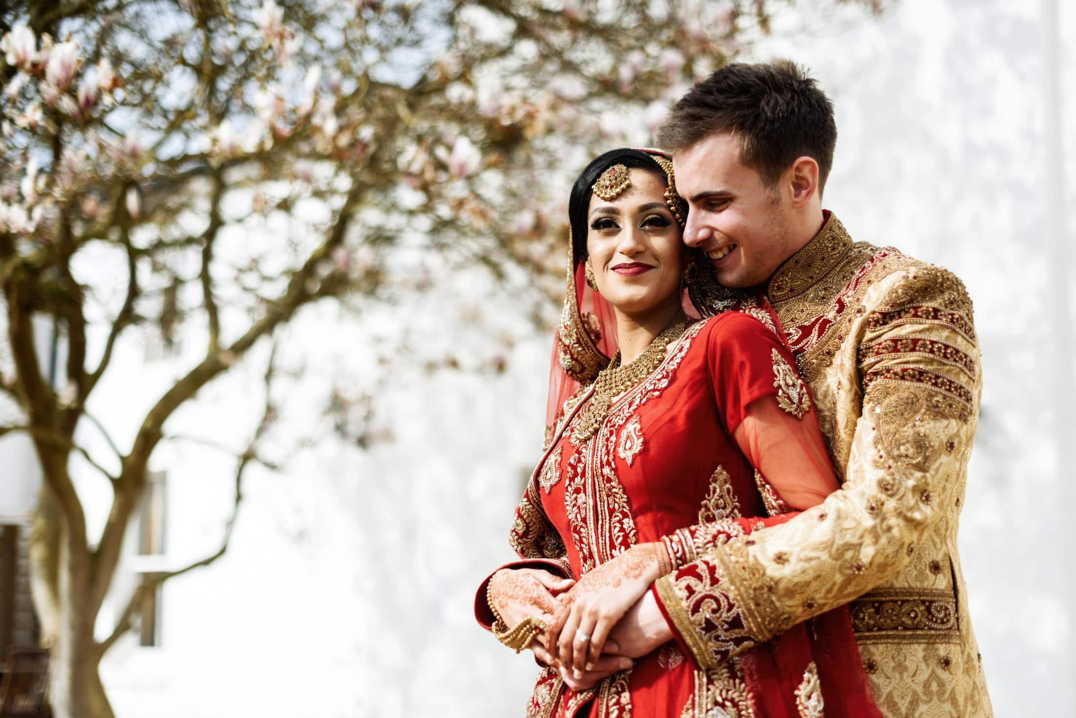 Bride and groom Indian wedding outfits at Warwick House